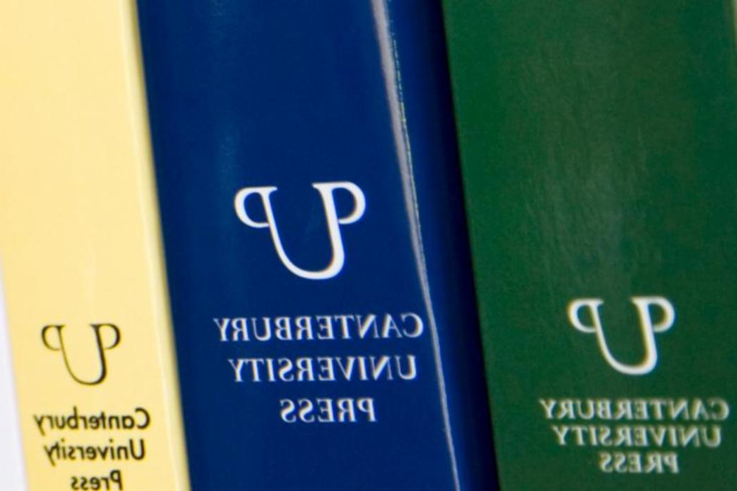 book spines with canterbury university press logo